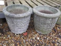 A pair of stone effect garden planters, 32cm tall x 35cm wide