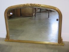 A modern gilt over mantle mirror, 68cm tall x 102cm wide, in good condition