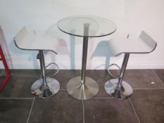 A glass top bar table, 91cm tall x 60cm diameter with two white laminated gas lift stools, some