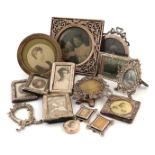 A collection of fourteen silver photograph frames, comprising: an Edwardian one of square form, by
