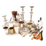 A mixed lot of electroplated items, comprising: a sandwich tray, a pair of candlesticks, a dwarf