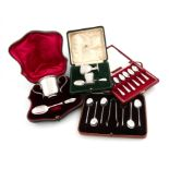 A mixed lot of silver items, various dates and makers, comprising: a cased two-handled cup and