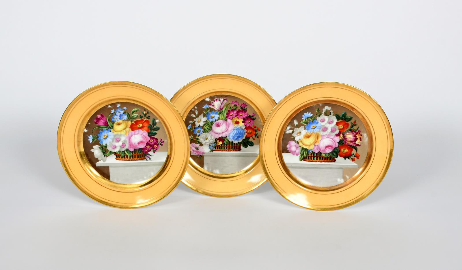 Lot 496 - Three Paris porcelain plates, 19th century, each painted with a basket of flowers including rose,