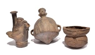 An Inca figure vessel Peru pottery, with a pointed base and a pair of open handles, 22cm high, a