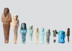 Seven Egyptian shabtis New Kingdom - Late Period, circa 1500 - 332 BC and later including a wood