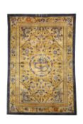 A RARE CHINESE IMPERIAL GOLD-GROUND SILK 'FIVE DRAGON' RUG LATE QING DYNASTY Decorated with a