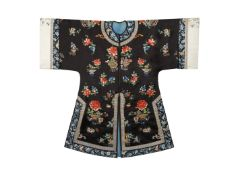 A CHINESE BLACK-GROUND EMBROIDERED SILK ROBE LATE QING DYNASTY Decorated with sprays of many