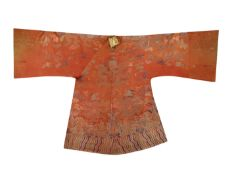 A CHINESE ORANGE-GROUND EMBROIDERED SILK 'DRAGON' ROBE LATE QING DYNASTY Decorated with the mythical