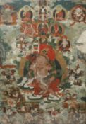 A TIBETAN THANGKA 19TH CENTURY Painted to the centre with Vaishravana seated upon a recumbent snow
