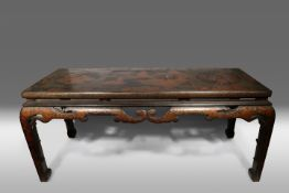 A CHINESE LACQUER TABLE 19TH CENTURY The rectangular top decorated in gold and red lacquer with a