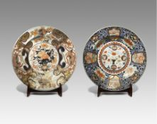 TWO MASSIVE JAPANESE IMARI CHARGERS EDO PERIOD, 18TH CENTURY Both decorated in underglaze blue,