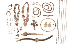 Various items of gold jewellery, including a bangle, two bracelets, a wristwatch, chains, earrings