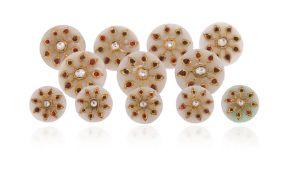 A set of twelve Indian gem-set jade buttons, each button applied with a gold foliate motif set