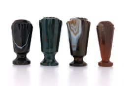 A collection of hardstone desk seals, the four banded agate seals with carved decoration, each