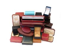 A collection of thirty jewellery boxes, including boxes by Cartier, Carrington, Harvey & Gore,