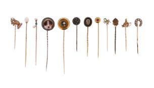 A cased set of twelve stick pins, including a rose-cut diamond-set circular pin in silver on gold, a