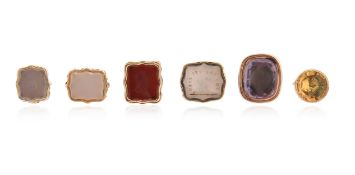 A set of six miniature fob seals, including a gold fob seal, the amethyst matrix carved with a