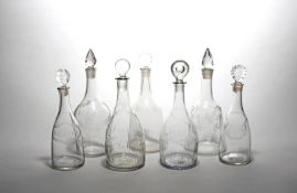Seven decanters and stoppers late 18th/19th century, most of mallet form, variously engraved with