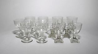 Two sets of six glass rummers early 19th century, with rounded funnel bowls, engraved with