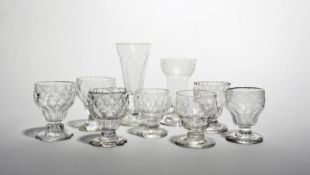 Nine jelly or sorbet glasses 18th/19th century, seven with rounded bowls moulded with honeycomb or