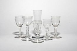 Six wine glasses c.1760-70, a pair with light moulding beneath a polished garland border, another