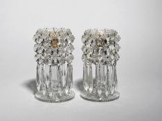 A pair of cut glass table lustres 19th century, hung with strings of circular and drop lustres,
