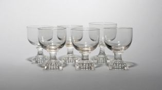 Six glass rummers 19th century, with generous rounded bowls raised on short stems and square lemon