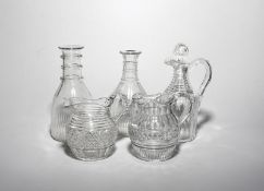 A pair of glass carafes early 19th century, cut with bands of polished lappets and shallow neck