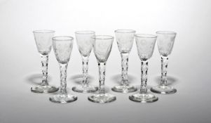 Seven wine glasses c.1770, each rounded funnel bowl engraved with a flower stem including narcissus,