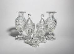 A pair of cut glass sweetmeat jars and covers 19th century, raised on octagonal bases, a pair of
