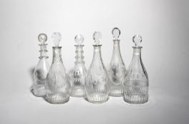 Six decanters and stoppers late 18th/19th century, of Prussian and mallet form, variously engraved