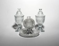 A pair of cut glass sweetmeat jars and covers 19th century, cut with diamond hobnail bands and
