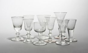 Nine small glasses 18th/19th century, with drawn trumpet, bucket and bell bowls raised on plain,