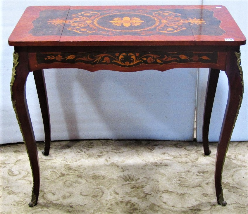 Lot 1336 - A good quality reproduction Italian floral marquetry inlaid games table, the reversible and