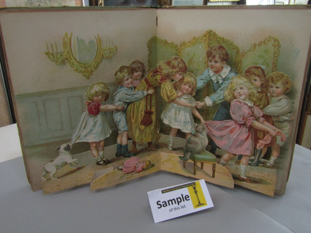 Lot 813 - A charming collection of antique children's books, many produced by Ernest Nister, London, including