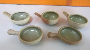 Probably by Bernard Leach - Three St Ives pottery wine tasting cups with celadon glaze interior,