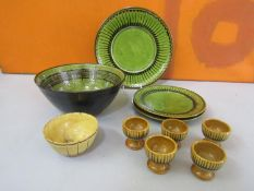 Collection of Coldstone pottery comprising three plates, five egg cups and a dish all with similar