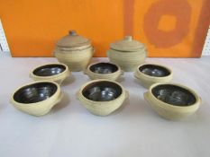 Leach style St Ives studio pottery brown glazed cookware comprising six soup bowls and two lidded