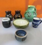 A mixed collection of studio pottery comprising a blue glazed jug, possibly by Michael Casson, a