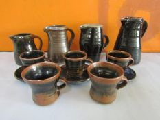 Collection of probably Leach pottery St Ives table wares all in brown glaze comprising four jugs,