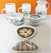 Marianne De Trey - Collection of stoneware studio pottery comprising two tankards, mug and jug all