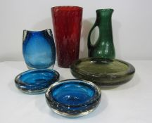 Whitefriars - Six pieces of bubbled glass comprising a tall red vase, a green gargoyle type jug, a
