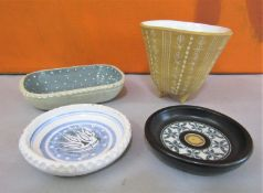 Ambleside Pottery - Four pieces of studio pottery comprising a three foot pot with incised
