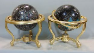 A pair of contemporary celestial and terrestrial globes, raised on brass frameworks, 30cm diameter