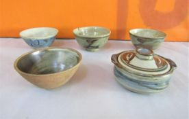 Probably by Bernard Leach of St Ives Pottery - Four pedestal dishes together with a further lidded
