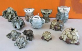 Briglin Pottery - A collection of novelty animal studio pottery figures and money boxes,