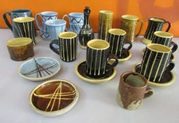 A collection of studio pottery by John Buccanan or Arch Pottery Cornwall comprising various mugs and