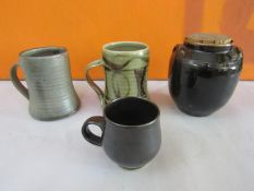 Harry Davis & May for Crowan Pottery two celadon glazed pint tankards together with a further