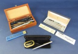 A miscellaneous collection of vintage fountain pens, propelling pencils, etc
