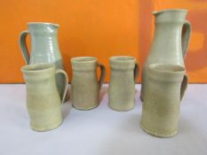Dorothy Kemp studio pottery celadon glaze pitcher and tankard set, together with a further jug (6)